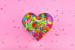 Colorful confetti candy and sweet marshmallow the form of heart stock images
