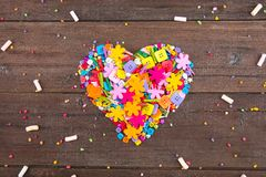 Colorful confetti candy and sweet marshmallow the form of heart stock photography