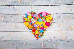 Colorful confetti candy and sweet marshmallow the form of heart royalty free stock photography