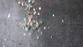 Colorful confetti falling stock video footage