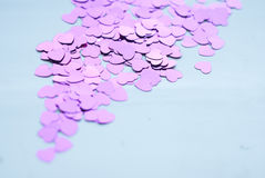 Colorful confetti on light background, little hearts rise up, Stock Photo