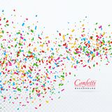 Colorful confetti and ribbons falling background. Colorful confetti and ribbons falling vector background Stock Photo