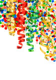 Colorful confetti with shiny streamer over white Royalty Free Stock Images