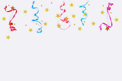 Colorful confetti stars, streamers on a light background. Stock Photography