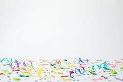 Colorful confetti and streamers. On white background royalty free stock photography