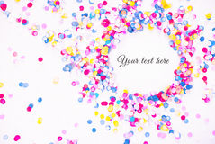 Colorful confetti on white background with text. Colorful confetti on white background with sample text stock images