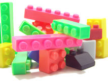 Colorful construction blocks. A set of small plastic pieces, such as a cube, bar, or cylinder, used as a building toy Stock Photos