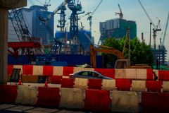 Colorful construction site with many cranes royalty free stock photos