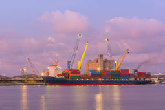 Colorful container and busy task on twilight. Stock Image