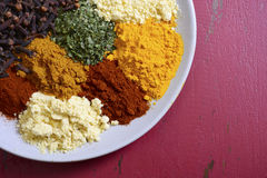 Colorful Cooking Spices On Wooden Table Royalty Free Stock Photos