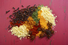 Colorful Cooking Spices On Wooden Table Stock Photos