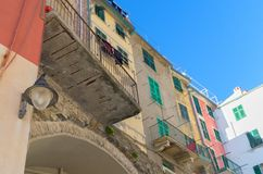 Colorful corner of the first houses on the sea, Riomaggiore, 5 terre, Liguria, Italy stock photography