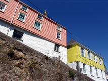Colorful Cornish houses. Colorful Cornish weatherboard seaside houses on clifftop stock images
