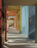 Colorful Corridor with columns and shadows on sunny day. Colorful columns. Abstract architectural photo, columns, diagonal, street Royalty Free Stock Image