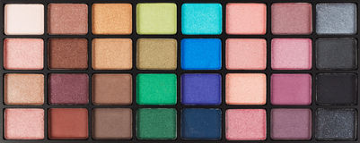 Colorful Cosmetic Eyeshadow Palette Set And Makeup Royalty Free Stock Photography