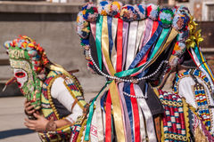 Colorful costumes and masks Stock Image