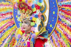 Colorful costumes worn by a participant. JEMBER - Indonesia. May 21, 2018: Colorful costumes worn by a participant at annual parade in Jember Festival Carnaval Stock Photos