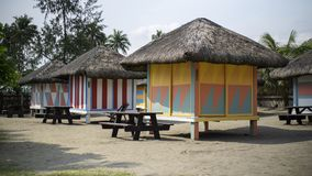 Colorful cottages in a beach resort stock images