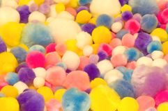 Colorful cotton balls. A abstract view of an assortment of bright cotton balls of different sizes and colors Royalty Free Stock Image