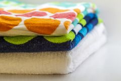 Colorful cotton bath towels on white background Royalty Free Stock Photography