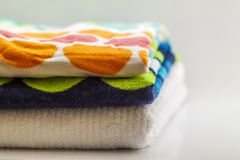 Colorful cotton bath towels on white background.  Royalty Free Stock Images