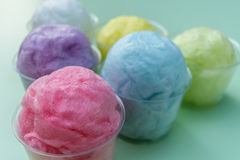 Colorful cotton candy in plastic cup Stock Photos