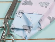 Colorful cotton fabric, meter and scissor Stock Images