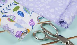 Colorful cotton fabric, meter and scissor Stock Photos