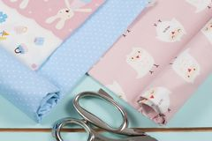 Colorful cotton fabric, meter and scissor Royalty Free Stock Image