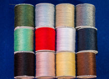 Colorful Cotton Reel Spools of Sewing Thread Stock Photography