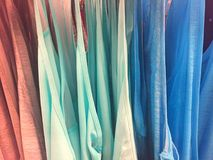 Colorful Cotton Shirts Hanging in a Row. Light and airy cotton shirt hanging in a row. A burst of pastel colors Royalty Free Stock Photo