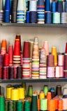 Colorful Cotton Thread Spools on Shelf Stock Image