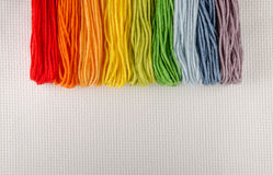 Colorful cotton threads for embroidery on canvas Royalty Free Stock Photos