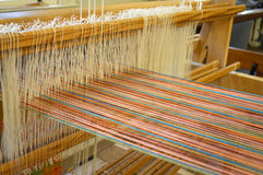 Colorful cotton threads on traditional weaving machine Royalty Free Stock Images