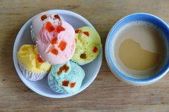 Colorful cotton wool cake on cup and coffee Royalty Free Stock Photos