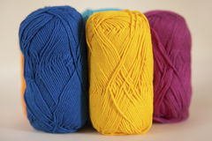 Colorful cotton yarn balls displayed for creative and handwork projects. Mercerised cotton skeins in vivid color for knitting and crocheting projects Stock Images