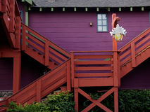 Colorful country house. With red stairway Stock Photos
