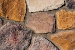 Colorful country natural stone brick wall texture background. Country werstern style Royalty Free Stock Photos