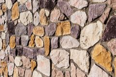 Colorful country natural stone brick wall texture background. Country style Stock Images