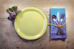 Colorful country place setting for a casual Hanukkah meal with dreidel. Horizontal aspect Stock Photos