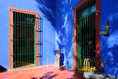Colorful courtyard at the Frida Kahlo Museum in Mexico City Royalty Free Stock Image