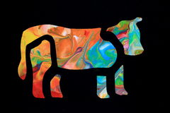 Colorful Cow. The symbolized outlined of a cow filled in with an abstract colorful artwork Royalty Free Stock Image