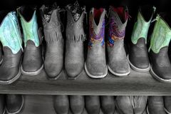 Colorful Cowboy Boots on Shelf Fashion Shoes Royalty Free Stock Images
