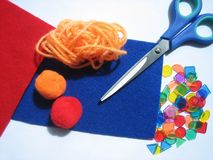 Colorful craft items. With woolens, beads and scissors Royalty Free Stock Photo