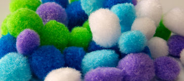 Colorful craft pompoms up close Stock Photos