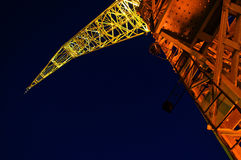 Colorful Crane at Night. A yellow and orange crane at night in Buenos Aires Stock Image