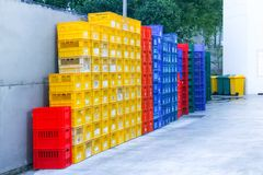 Colorful crate plastic. stacked fruit packing containers stock photography