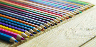 Colorful crayon pencil on the wooden floor Stock Photos