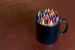 Colorful crayon pencils in a pen tray Stock Photography