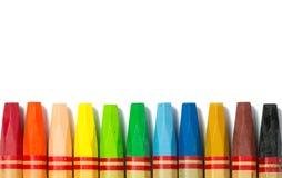 Colorful crayon in a row Stock Photos